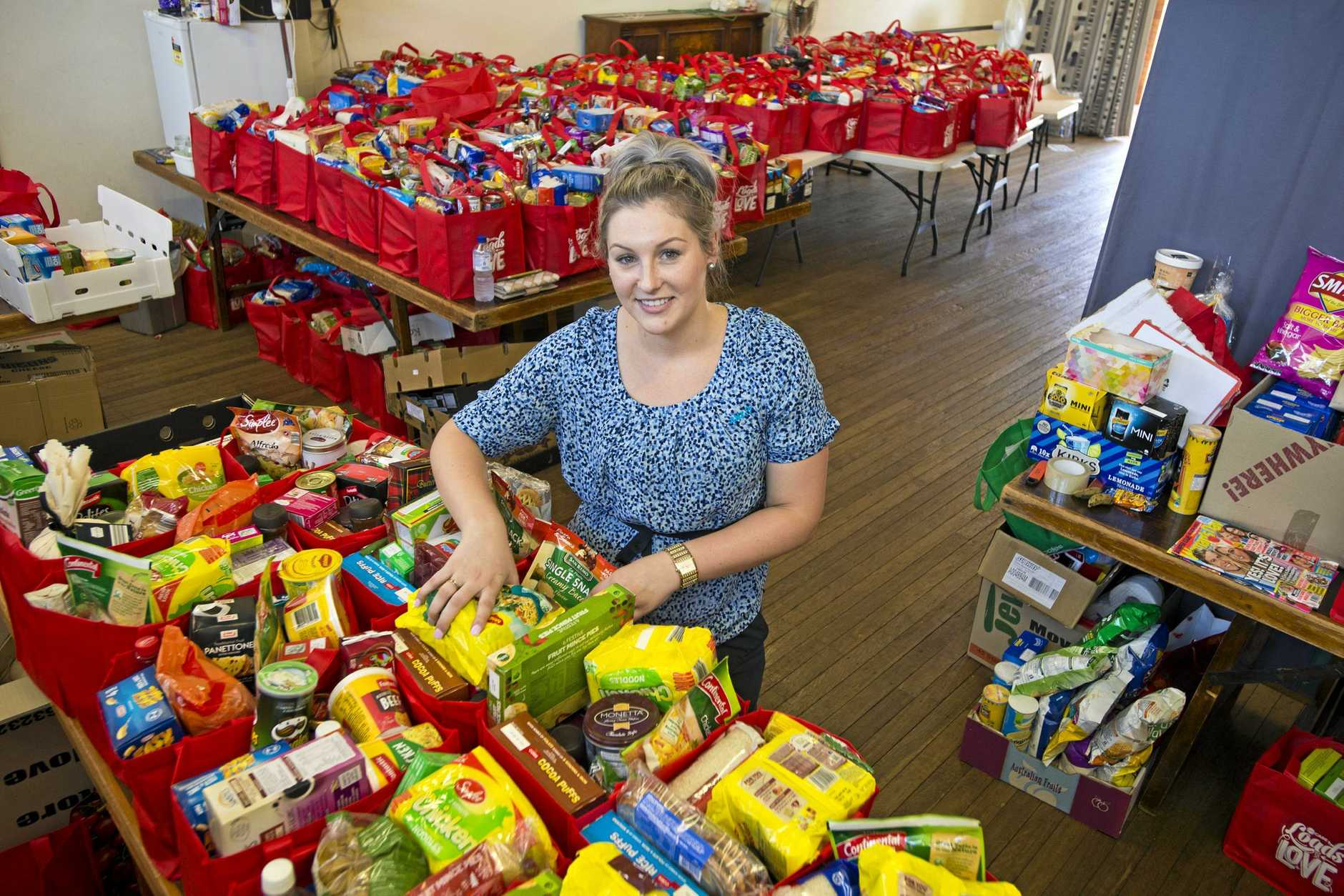 Volunteering for Lifeline from ANZ is Stephanie Thrupp working with Metro Care Loads of Love Appeal at the Lifeline distribution centre, Monday, December 18, 2017.