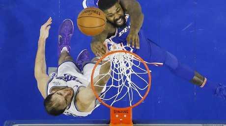 Trevor Booker, top, tries to get a shot past Sacramento Kings' Kosta Koufos. (AP Photo/Matt Slocum)