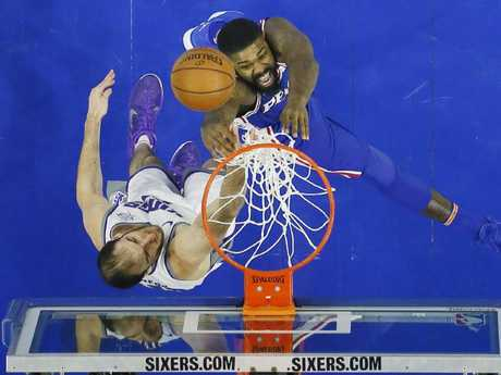 Trevor Booker, top, tries to get a shot past Sacramento Kings' Kosta Koufos. (AP Photo/Matt Slocum)