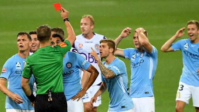 Melbourne City's Osama Malik is sent off against Perth Glory last month following a VAR review.