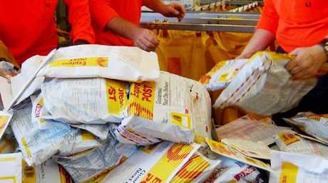 Aussie slackers are relying on the yellow post parcels 35 per cent more than least year. Picture: Stewart McLean