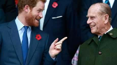 Prince Harry shares a laugh with Prince Philip, Duke of Edinburgh. Picture: Supplied