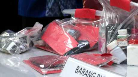The suspects' alleged drug hauls were also on display for the eager press pack. Picture: Lukman Bintoro