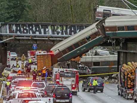 Cars from an Amtrak train that derailed spilled onto Interstate 5 on Monday. Picture: Peter Haley/The News Tribune via AP