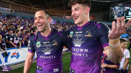 Curtis Scott (right) celebrates this year's grand final win with Cameron Smith.