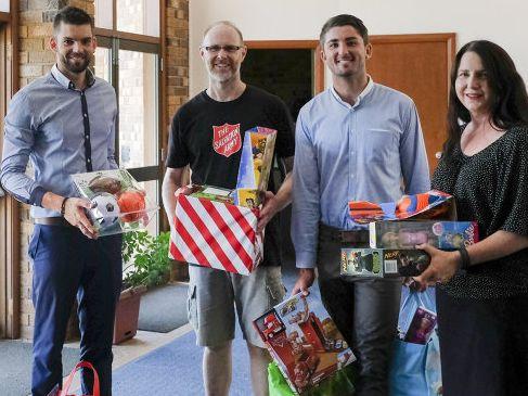 Benny Holder, Jake Korehnert and Sarah Kay of Elders Grafton delivering donations to Salvation Army Minister Martin Herring.