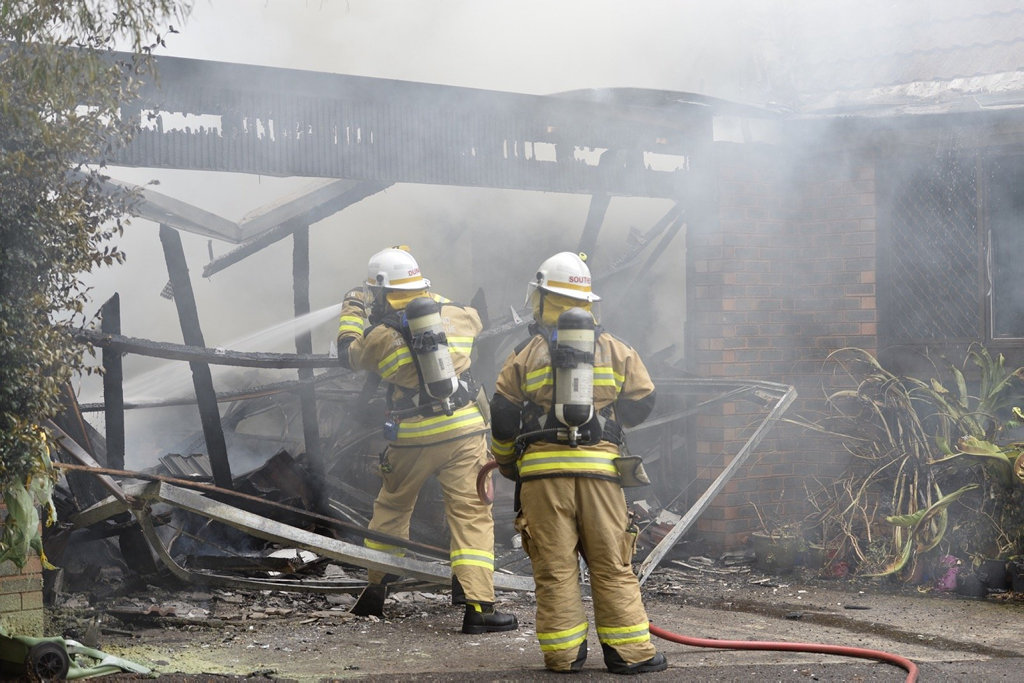 Emergency crews are battling a blaze in Rangeville after a vehicle in a carport caught fire.