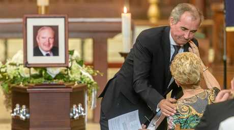 Member for Clarence Chris Gulaptis gives a hug to Florence Robinson after he gave a tribute at former member for Cowper and Page Ian Robinsons' funeral at the Christ Church Cathedral.