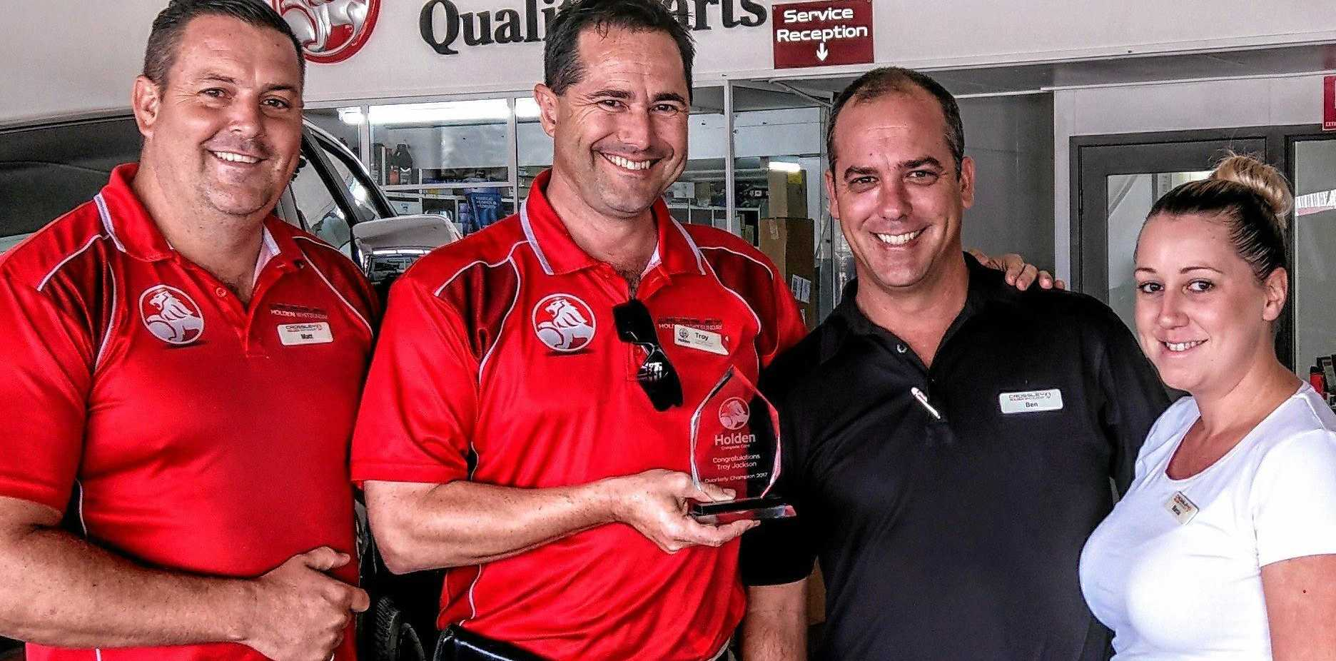 GREAT SERVICE: Crossley Holden Whitsunday staff Matthew Pettigrove, Troy Jackson with owner Ben Hancock and Marcia Bowder holding their customer service award.