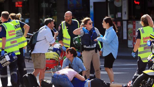 Paramedics treat a number of pedestrians. Aaron Francis/The Australian Source:News Corp Australia