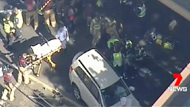 Channel 7 helicopter footage of the chaotic scene, showing the white SUV. 7 NEWS