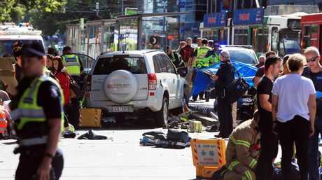 Emergency services treat a number of pedestrians at the scene. Picture: Aaron Francis/The Australian