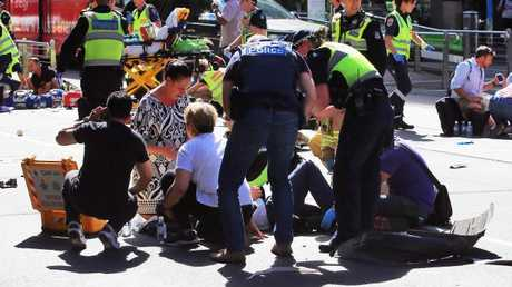 Police, fire and paramedics treat a number of pedestrians. Picture: Aaron Francis/The Australian