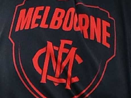 The Melbourne Demons Football Club crest.