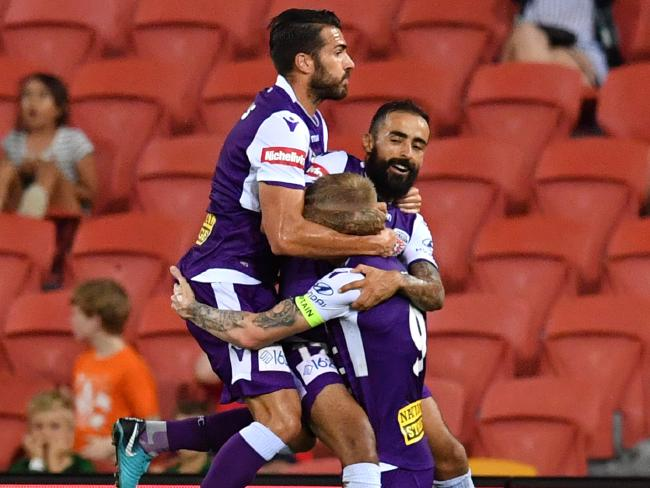 Diego Castro (right) celebrates with teammates Xavier Torres (left) and Andy Keogh.