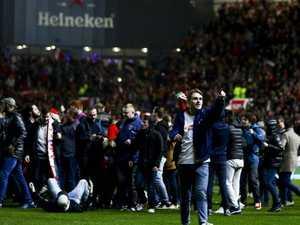 Roo revels in wild scenes, historic Utd shock