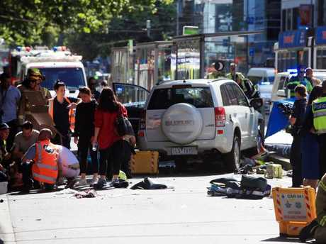A number of pedestrians are treated on Flinders St. Picture: Aaron Francis
