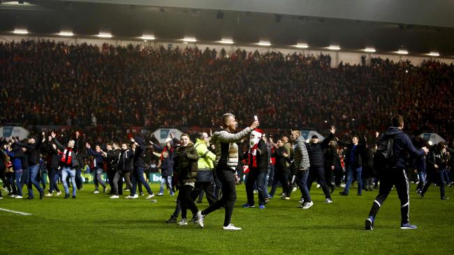 Bristol City fans celebrate their victory as they invade the pitch
