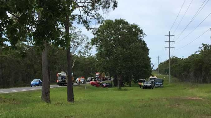 Emergency crews attend a three-vehicle crash on the Bruce Hwy, north of Maryborough.
