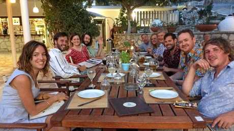 The honeymoon party ready to enjoy another Greek island feast.