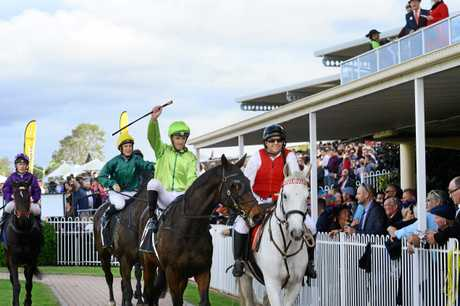 Jockey Michael Cahill celebrates after riding Self Sense to victory in the Ipswich Cup.