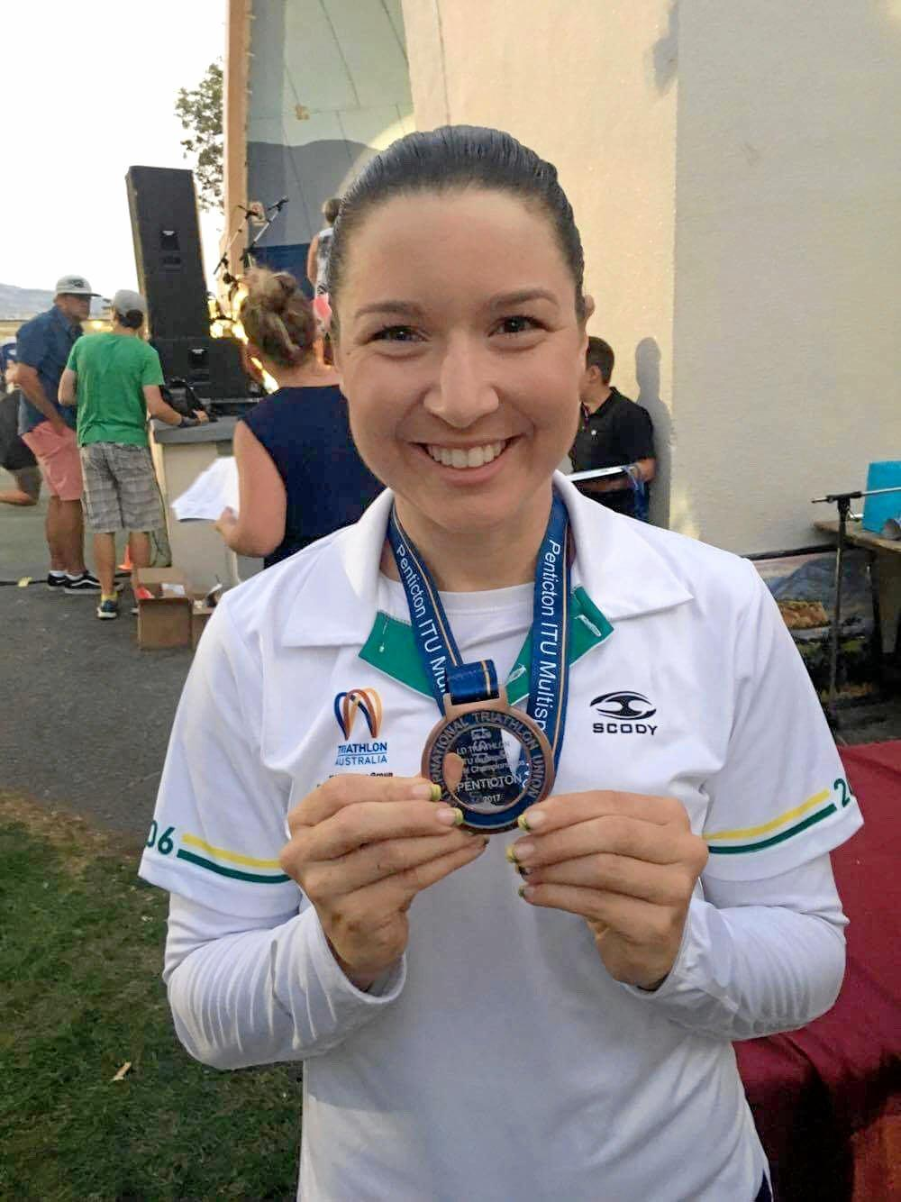 Ipswich triathlete Rebecca Ungermann winning a bronze medal at the longcourse world championships in Canada.