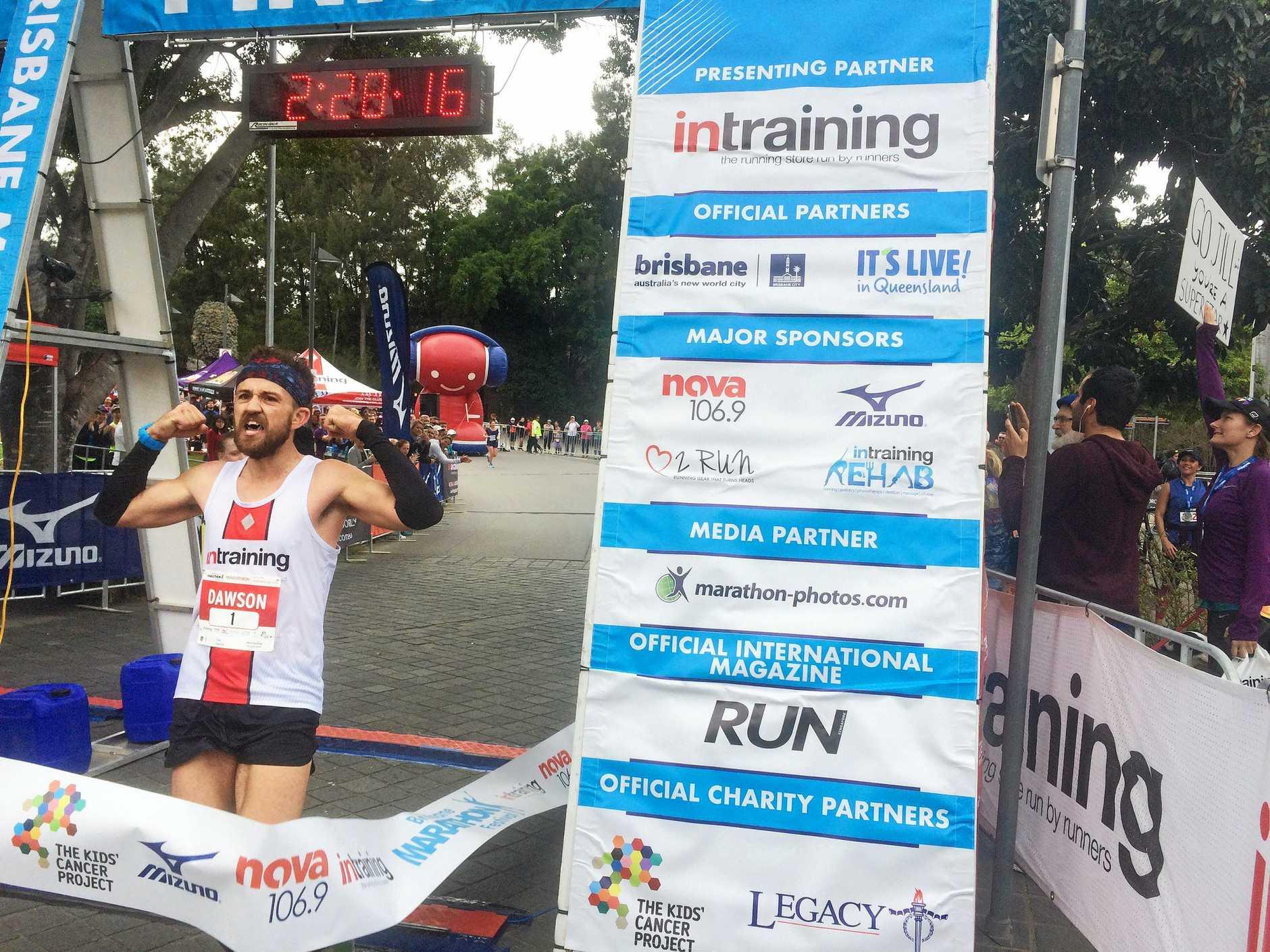 Ipswich runner Clay Dawson shows his delight at winning the Brisbane Marathon.Photo: Contributed