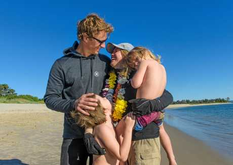 Hayley Talbot (centre) gets a hug from husband Michael and children Archie and Phoenix after she completed her 400km kayak down the Clarence River.