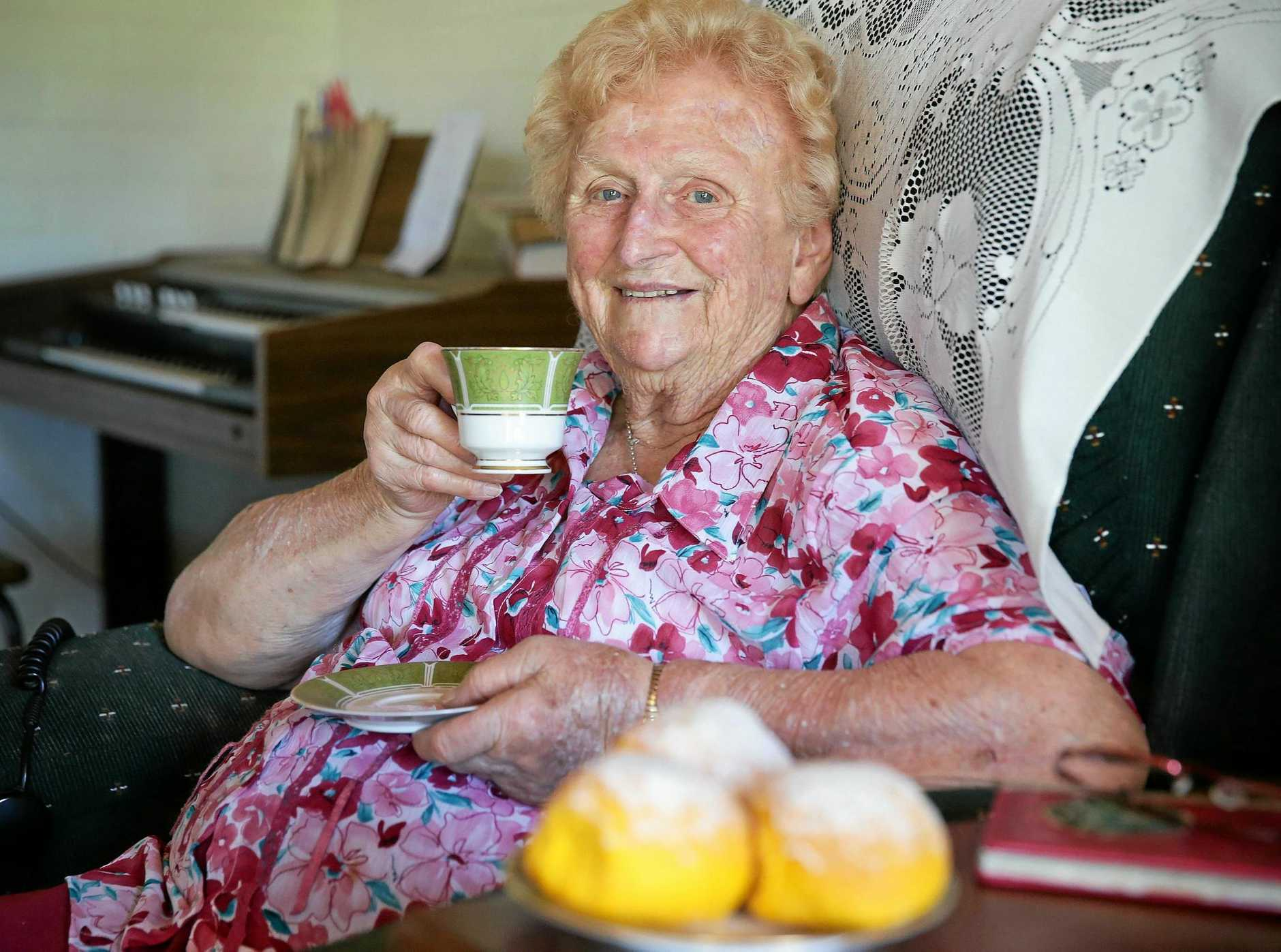 WELL LOVED: Lady Flo Bjelke-Petersen having tea and pumpkin scones at Bethany, Kingaroy.