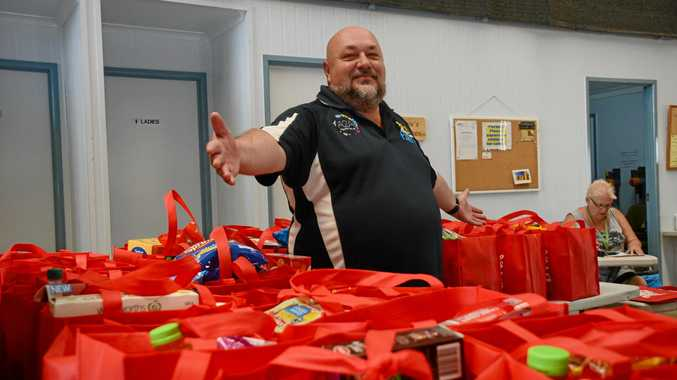SO MUCH TO GIVE: Jim Bennett from the South Burnett Pantry says the number of families asking for help over the festive season has increased considerably.