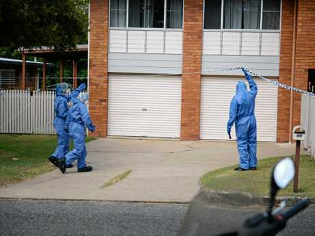 Police at the Mills Ave property where Tracey Hill had rented just six weeks earlier.