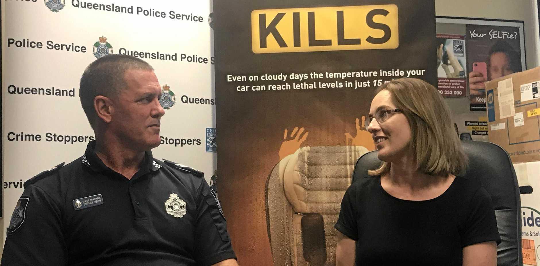 Senior Constable Steve Smith with Catherine Whitehead.