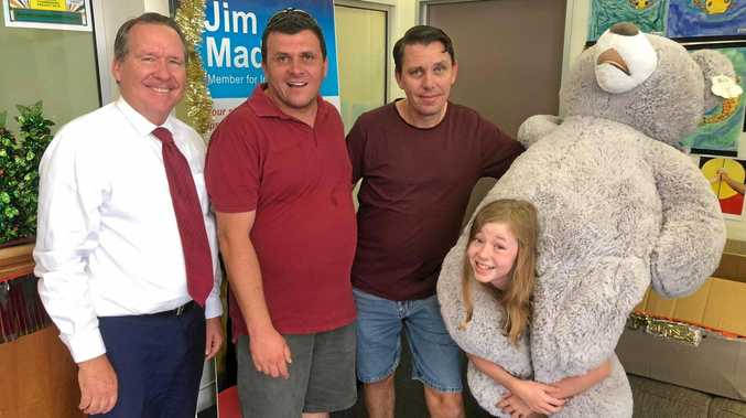 GIFTS: Ipswich West MP Jim Madden, Brassall Estates' Damian Hamilton with Daniel and Cadence Arnold.