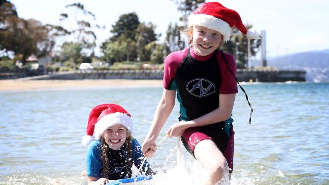 It's going to be a classic Aussie summer for the Christmas weekend. Laura Sypkes, 11, and Ruby Muggerridge, 10, are keen for the warm weather. Picture: LUKE BOWDEN