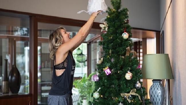 Lorna Jane decorating her Christmas tree.
