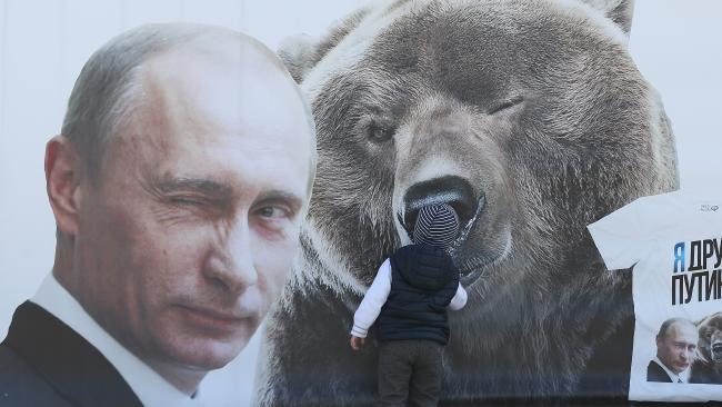 Russian President Vladimir Putin and a bear.