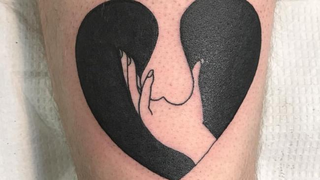 People can't work out if this tattoo of a heart is actually something a lot ruder. Picture: @gutphobia/Twitter