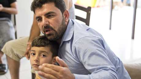Raad Khairo and son Ammar, Yazidi refugees in Toowoomba.