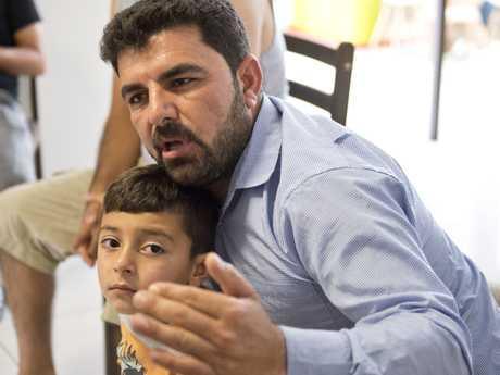 Raad Khairo and son Ammar, Yazidi refugees in Toowoomba.