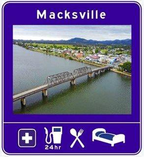 New signs have been installed as part of a pilot program to promote Macksville and other bypassed towns in rural and regional NSW.