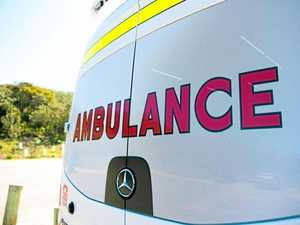 Paramedics assist as man comes off motorbike at Nikenbah