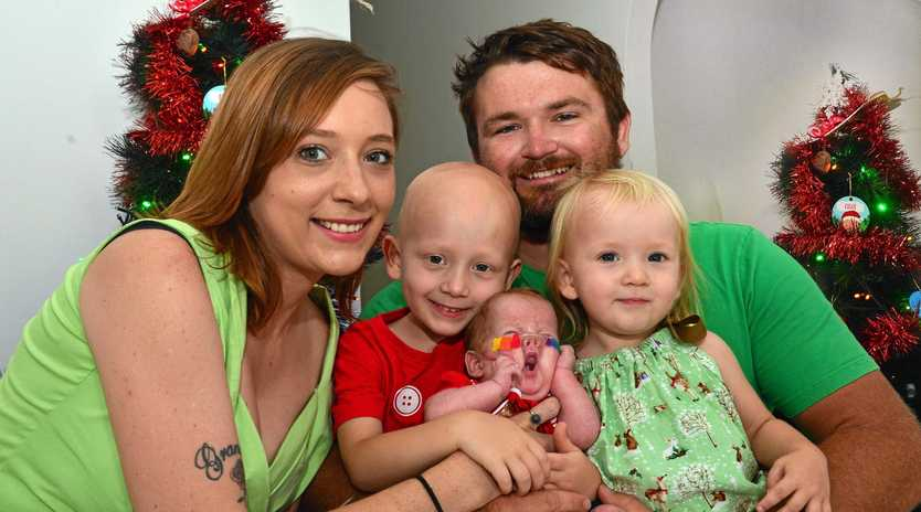 SPECIAL MILESTONE: Edward Maher is surrounded by his mum Haylee Spreadborough, brother Malcolm, 4, dad Warrick Maher and sister Chloe, 2, at their Wurtulla home.