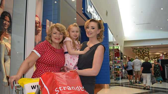 RETAIL THERAPY: Karyn de Vere, Amelia Novak and Emma Novak shopping in Gympie Central shopping centre. A number of major retailers in Central and right across town will be open today for the Boxing Day sales.
