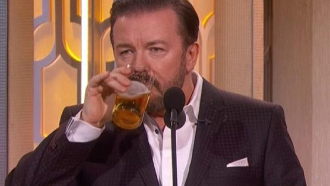 Ricky Gervais drinking knocks back a beer onstage at the 2016 Golden Globe Awards. Picture: NBC