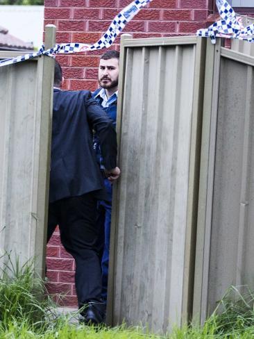 Investigators go into the backyard. Picture: Jenny Evans