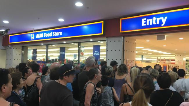 Hundreds of people gather outside Aldi during selected Special Buys sales.