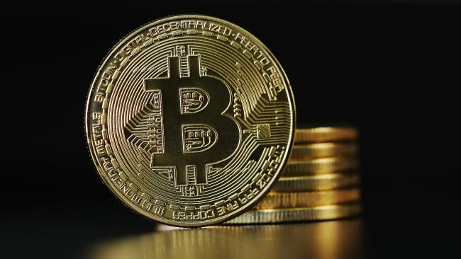 The value of bitcoin has plummeted after a massive boom, leading critics to declare the cryptocurrenty 'a scam'.