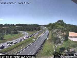 Traffic queues behind three-vehicle Bruce Highway crash