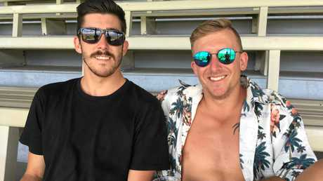 Tom Elliot and Alex Killorn from Byron Bay escaped the heat in the grandstand.