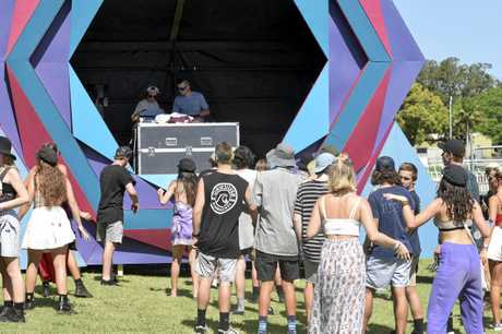 RIGHT VIBES: Revellers move toward the stage as the Violet Vibes music festival gets into full swing at Grafton Racecourse.